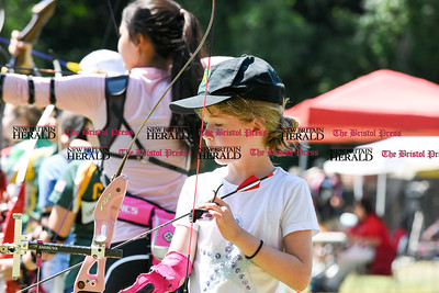 062516  Wesley Bunnell | Staff  The Nutmeg State Games & CTAA Archery Tournament drew competitors from several states to Hungerford Park on Saturday morning.  Whitney Williams, age 8, of Concord Mass stands on the line.