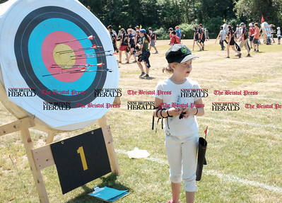 062516  Wesley Bunnell | Staff  The Nutmeg State Games & CTAA Archery Tournament drew competitors from several states to Hungerford Park on Saturday morning.  Whitney Williams, age 8, of Concord Mass checks her target.