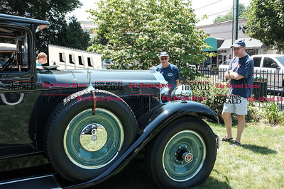 062516  Wesley Bunnell | Staff  Friends of the Barnes Museum held their second annual Wheels of the Past classic car show on Saturday morning. Jack Brooks, middle, admiring a 1930 Packard.