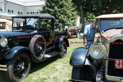 062516  Wesley Bunnell | Staff  Friends of the Barnes Museum held their second annual Wheels of the Past classic car show on Saturday morning. Al Creto of Wallingford examines a 1927 Buick.