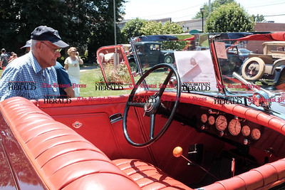 062516  Wesley Bunnell | Staff  Friends of the Barnes Museum held their second annual Wheels of the Past classic car show on Saturday morning. Al Creto of Wallingford viewing the inside of a 1932 Chrysler convertible.
