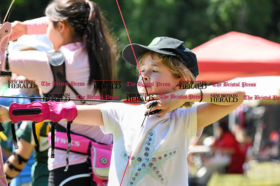 062516  Wesley Bunnell | Staff  The Nutmeg State Games & CTAA Archery Tournament drew competitors from several states to Hungerford Park on Saturday morning.  Whitney Williams, age 8, of Concord Mass ready to shoot.