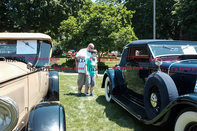 062516  Wesley Bunnell | Staff  Friends of the Barnes Museum held their second annual Wheels of the Past classic car show on Saturday morning. Andy Modeen left with Benjamin Modeen , age 12, both of Middelbury stand between a 1927 Buick & a 1932 Lincoln LeBaron convertible.
