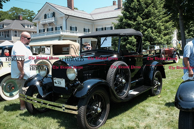 062516  Wesley Bunnell | Staff  Friends of the Barnes Museum held their second annual Wheels of the Past classic car show on Saturday morning. Andy Modeen left with Benjamin Modeen , age 12, both of Middelbury viewing a 1930 Model A.
