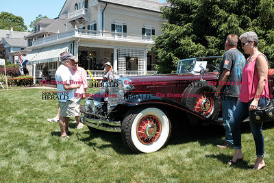 062516  Wesley Bunnell | Staff  Friends of the Barnes Museum held their second annual Wheels of the Past classic car show on Saturday morning. From the R Kelly & Jeff Boga of Southington standing near a 1931 Chrysler.