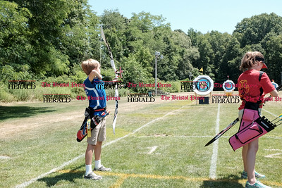 062516  Wesley Bunnell | Staff  The Nutmeg State Games & CTAA Archery Tournament drew competitors from several states to Hungerford Park on Saturday morning.  Alexander Bruno, age 9, of Hudson Mass on the left.