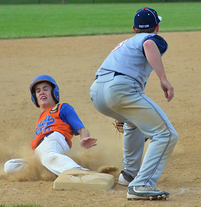 KYLE MENNIG - ONEIDA DAILY DISPATCH Oneida Post's Tanner Williams (10) slides safely into third, under the tag of Sherrill Post's Blake VanDreason (3) during their game in Sherrill on Wednesday, June 15, 2016.