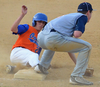 KYLE MENNIG - ONEIDA DAILY DISPATCH Oneida Post's Brad Mallinder (21) slides safely into third after a wild pitch as Sherrill Post's Blake VanDreason (3) awaits the throw during their game in Sherrill on Wednesday, June 15, 2016.