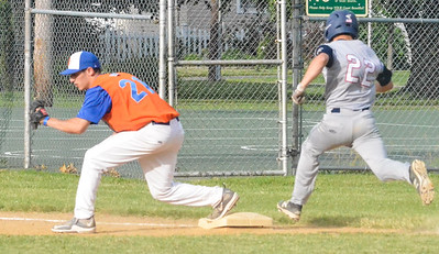 KYLE MENNIG - ONEIDA DAILY DISPATCH  Oneida Post's Brad Mallinder (21) forces Sherrill Post's Nate Palmer (22) out at first during their Legion Baseball game on Wednesday.