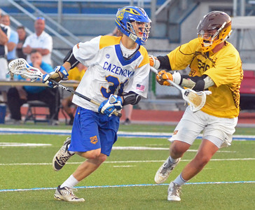 KYLE MENNIG - ONEIDA DAILY DISPATCH Cazenovia's Derek White (31) brings the ball up the field as Canton's Garret Glasgow (3) defends during their NYSPHSAA Class C regional semifinal game in Cicero on Wednesday, June 1, 2016.