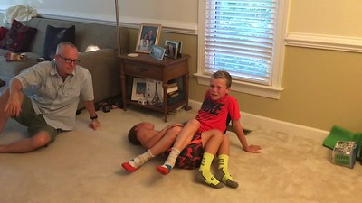 Bench pressing their brother