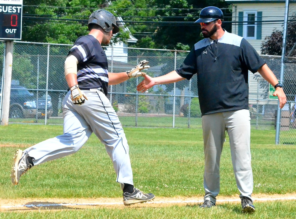 . KYLE MENNIG � ONEIDA DAILY DISPATCH Sherrill�s Michael Wroth, left, is congratulated by coach Jimmy Hegmann after hitting a home run against Rome during their NYCBL game in Sherrill on Saturday, June 17, 2017.
