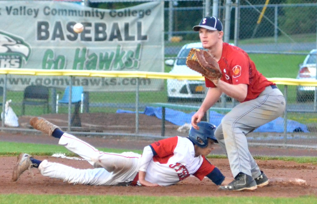 . KYLE MENNIG � ONEIDA DAILY DISPATCH Utica Post�s Josh Raymer (7) dives safely back into first as Sherrill Post�s Davey Moffett (5) awaits a pickoff throw during their American Legion Baseball game in Utica on Tuesday, June 20, 2017.