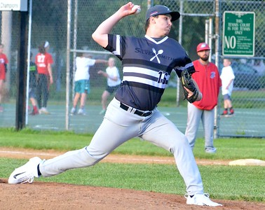 KYLE MENNIG - ONEIDA DAILY DISPATCH Sherrill Silversmiths' pitcher Devin Long delivers a pitch to a Syracuse Salt Cats batter during their game in Sherrill on Friday, June 2, 2017.