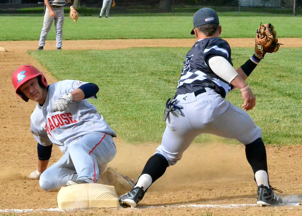 . KYLE MENNIG - ONEIDA DAILY DISPATCH A Syracuse Salt Cats player slides safely into third, beating the tag of Sherrill Silversmith Joshua Goldstein (9) during their game in Sherrill on Friday, June 2, 2017.