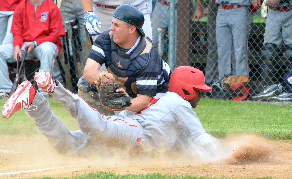 . KYLE MENNIG - ONEIDA DAILY DISPATCH Syracuse Salt Cat Craig Alleyne (7) dives safely into home under the tag of Sherrill Silversmiths\' catcher Matthew Fitzgerald (7) during their game in Sherrill on Friday, June 2, 2017.