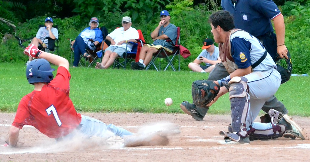 . KYLE MENNIG � ONEIDA DAILY DISPATCH Sherrill Post�s Zach Nell (7) slides safely into home as Helmuth-Ingalls Post catcher Thomas Labayweski (25) fields the throw during their game in Clinton on Friday, June 23, 2017.