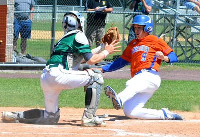 KYLE MENNIG - ONEIDA DAILY DISPATCH Oneida's Casey Rich (9) slides into home as Seton Catholic Central catcher Zach Pruden (2) puts the tag down during their NYSPHSAA Class B regional final in Endicott on Saturday, June 3, 2017.