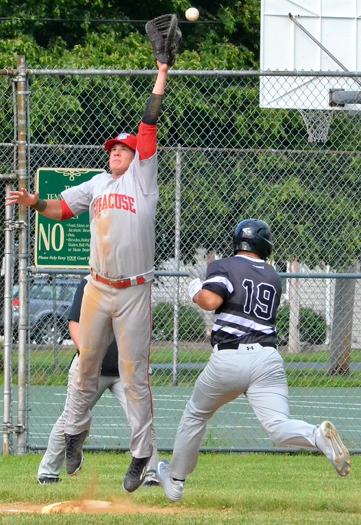 . KYLE MENNIG - ONEIDA DAILY DISPATCH Sherrill Silversmiths Kingsley Ballao (19) safely reaches first as the ball gets away from the Syracuse Salt Cats first baseman during their game in Sherrill on Friday, June 2, 2017.