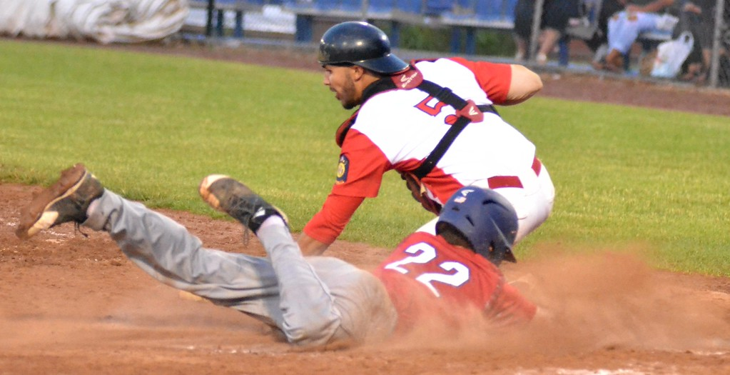 . KYLE MENNIG � ONEIDA DAILY DISPATCH Sherrill Post\'s Nate Palmer (22) dives safely into home to score a run, beating the tag of Utica Post\'s Nick LaBella (5) during their American Legion Baseball game in Utica on Tuesday, June 20, 2017.