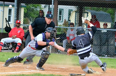 KYLE MENNIG - ONEIDA DAILY DISPATCH Sherrill Silversmith Jake Coro (4) sides safely into home as the ball gets away from Syracuse Salt Cats catcher Matthew Nerz during their game in Sherrill on Friday, June 2, 2017.