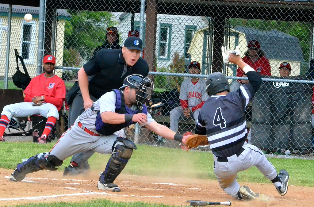 . KYLE MENNIG - ONEIDA DAILY DISPATCH Sherrill Silversmith Jake Coro (4) sides safely into home as the ball gets away from Syracuse Salt Cats catcher Matthew Nerz during their game in Sherrill on Friday, June 2, 2017.