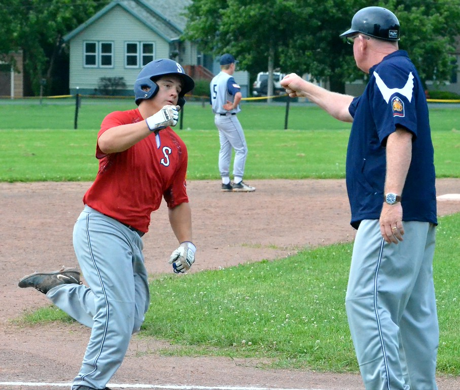 . KYLE MENNIG - ONEIDA DAILY DISPATCH Sherrill Post\'s Ryan Palmer, left, is congratulated by coach John Roden after hitting a solo home run against Helmuth-Ingalls Post during their game in Clinton on Friday, June 23, 2017.