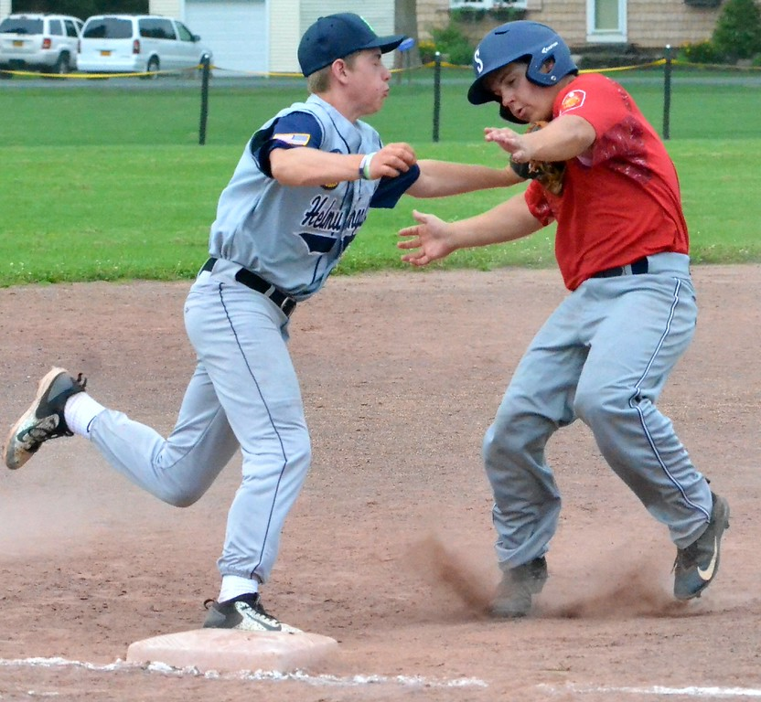 . KYLE MENNIG - ONEIDA DAILY DISPATCH Sherrill Post\'s Ryan Palmer, right, is tagged out trying to advance to third by Helmuth-Ingalls\' Mike Kelly during their game in Clinton on Friday, July 23, 2017.