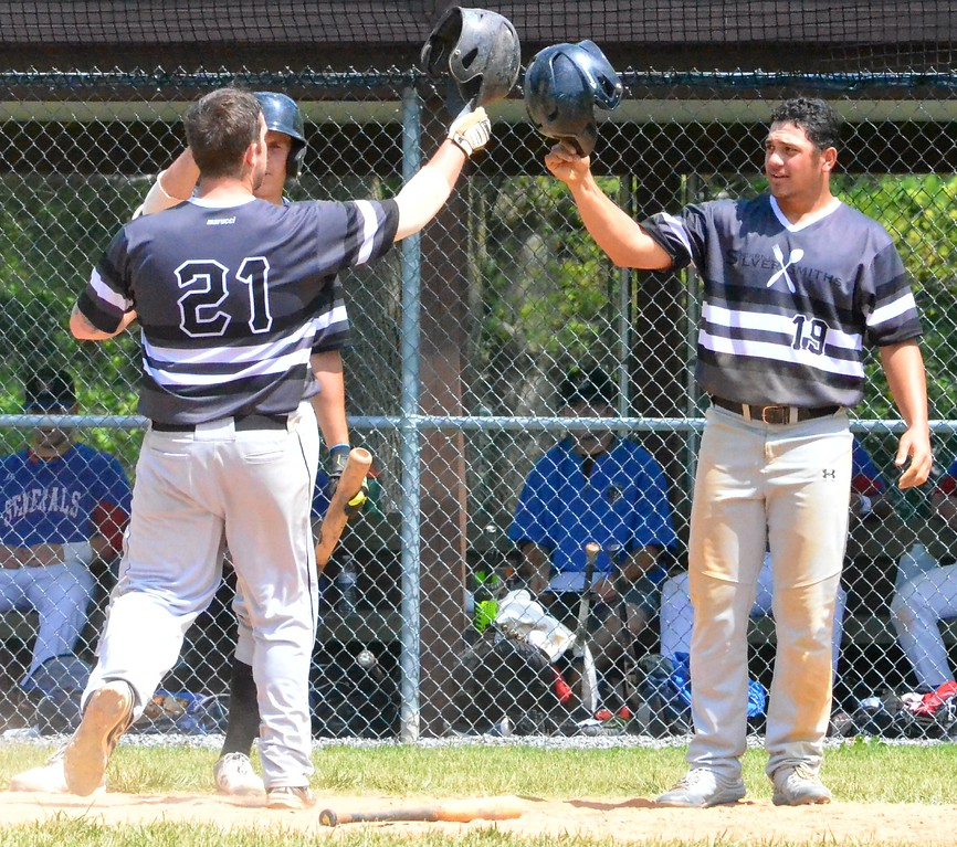 . KYLE MENNIG � ONEIDA DAILY DISPATCH Sherrill�s Kingsley Ballao (19) congratulates teammate Michael Wroth (21) after Wroth hit a home run against Rome during their NYCBL game in Sherrill on Saturday, June 17, 2017.