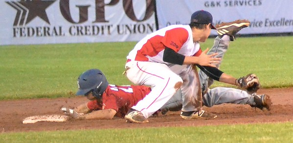 KYLE MENNIG – ONEIDA DAILY DISPATCH Sherrill Post's Nate Palmer (22) dives safely into second for a stolen base, beating the tag of Utica Post's Mike Cough during their American Legion Baseball game in Utica on Tuesday, June 20, 2017.