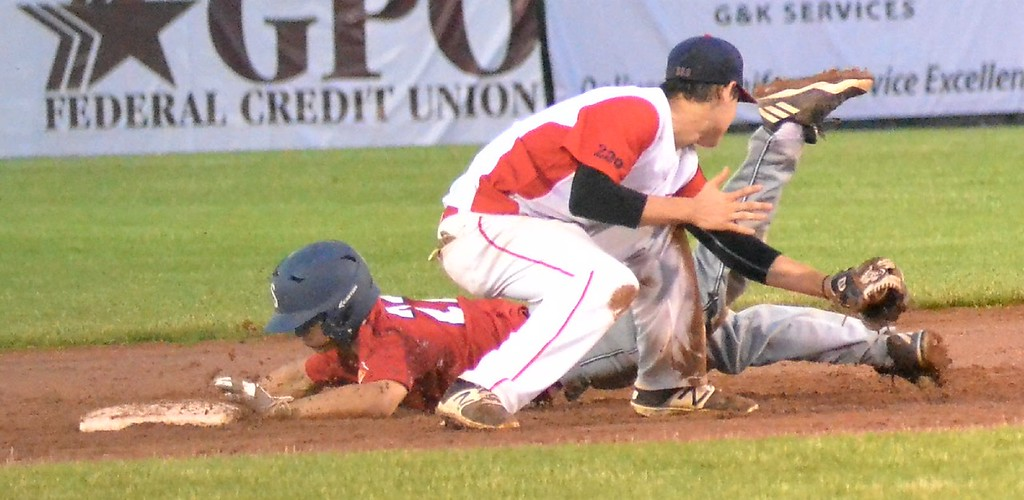 . KYLE MENNIG � ONEIDA DAILY DISPATCH Sherrill Post\'s Nate Palmer (22) dives safely into second for a stolen base, beating the tag of Utica Post\'s Mike Cough during their American Legion Baseball game in Utica on Tuesday, June 20, 2017.