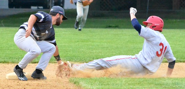 KYLE MENNIG - ONEIDA DAILY DISPATCH Sherrill Silversmiths Tully Allen (1) tags out Syracuse Salt Cat Jack McCarty (31) at second during their game in Sherrill on Friday, June 2, 2017.