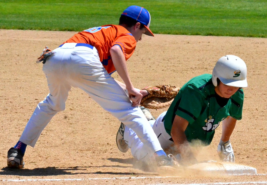 . A Seton Catholic Central playe dives back into first ahead of the tag from Oneida\'s Dan Myatt (18) during their NYSPHSAA Class B regional final in Endicott on Saturday, June 3, 2017.