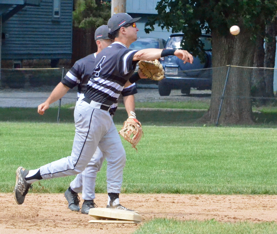 . KYLE MENNIG � ONEIDA DAILY DISPATCH Sherrill Silversmiths shortstop Jake Coro steps on second and throws to first to turn a double play against the Rome Generals during their game in Sherrill on Saturday, June 24, 2017.