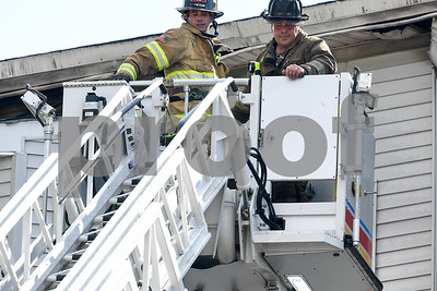 062717  Wesley Bunnell | Staff  A fire broke out Tuesday afternoon at 404 East St in New Britain on the top floor. Firefighters lower themselves onto the ladder truck.