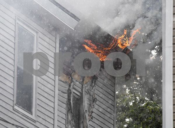 062717 Wesley Bunnell | Staff A fire broke out Tuesday afternoon at 404 East St in New Britain on the top floor. Fire on the back right hand corner of the house just before being put out.