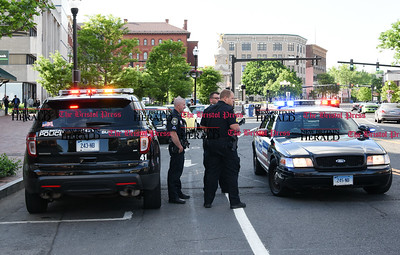 053117  Wesley Bunnell | Staff  New Britain police responding to reports of a person with a machete on Main St. Wednesday afternoon. No machete was found but one person was arrested for drug possession. Several police cars lined Main St with officer responding with automatic weapons as shown.