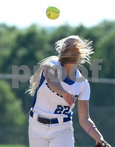 060217  Wesley Bunnell | Staff  Southington High softball defeated E.O. Smith in a quarterfinal game on Friday afternoon. Chrissy Marotto (22) with a face full of hair after making the throw to first.