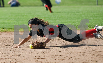 060217  Wesley Bunnell | Staff  Southington High softball defeated E.O. Smith in a quarterfinal game on Friday afternoon. Allyson Petrella (3) makes a diving stop.