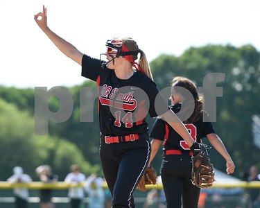 060217  Wesley Bunnell   Staff  Southington High softball defeated E.O. Smith in a quarterfinal game on Friday afternoon. E.O. Smith's Christine Guyette (14) motions two outs to teammates.