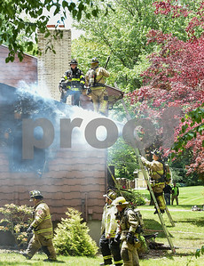 060217  Wesley Bunnell | Staff  Fire destroyed a raised ranch home at 186 Ellsworth Blvd around noon time on Friday in the Kensington section of Berlin. Multiple fire departments responded including Berlin, Newington, Meriden, Cromwell, Rocky Hill & Wethersfield. Fire still smolders from the side of the home.