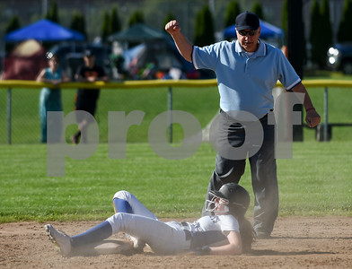 060217  Wesley Bunnell | Staff  Southington High softball defeated E.O. Smith in a quarterfinal game on Friday afternoon. Sarah Myrick (19) is surprised at being called out at second base on an attempted steal.