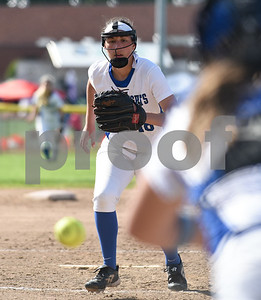 060217  Wesley Bunnell | Staff  Southington High softball defeated E.O. Smith in a quarterfinal game on Friday afternoon. Pitcher Kara Zazzaro (18) tracks down a ball hit back in front of the plate.