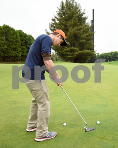 060517 Wesley Bunnell | Staff  Joe Walczyk practices on the putting green on Monday evening at Stanley Golf Course.