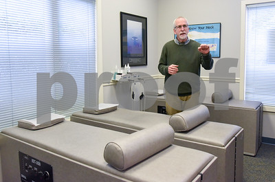 060517 Wesley Bunnell | Staff  Dr. Stuart Horen from Horen Chiropractic stands in one of his therapy rooms.