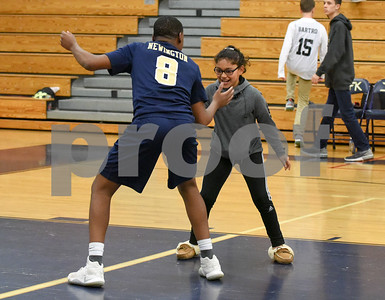 060617 Wesley Bunnell | Staff  Newington boys volleyball defeated Joel Barlow at Kennedy High School in Waterbury in a semi final game to advance to the championship game to be played on June 8. Louis Egbuna (8) celebrates after the win with a fan.