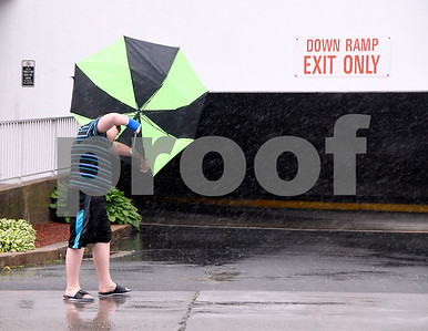 6/6/2017 Mike Orazzi | Staff A pedestrian struggles with an umbrella during Tuesday's rainfall on North Main Street in Bristol.