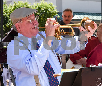 061417  Wesley Bunnell | Staff  Dave Mechler plays the trumpet during The Survivors Swing Band's concert for the lunchtime crowd on Wednesday at Central Park.