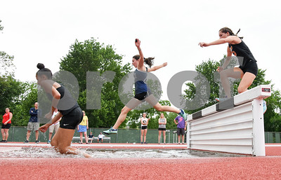 061317  Wesley Bunnell | Staff  The CIAC Decathlon, Heptathlon, Hammer Throw & Steeplechase Championships took place Monday & Tuesday at Veteran's Stadium in New Britain. A Southington runner jumps into the water over the steeplechase obstacle.