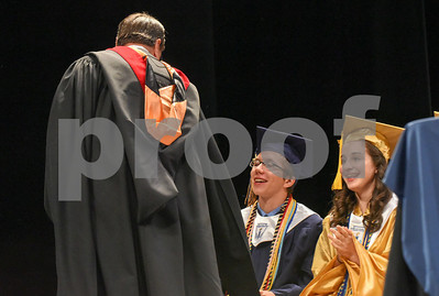 062017  Wesley Bunnell | Staff  Newington High School held their 2017 commencement at the Oakdale Theatre on Tuesday evening. Retiring Principal Jim Wenker walks past class President Jeremy Rippel and Valedictorian Teodora Markova on his way to deliver his speech.